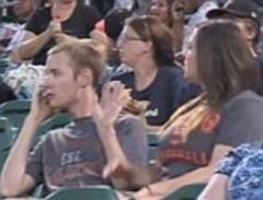 hilarious moment girlfriend pours drink over boyfriend on kiss cam because he kept talking on his phone