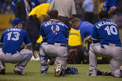 blue jays pitcher j.a. happ removed on stretcher as jays win another dramatic comeback
